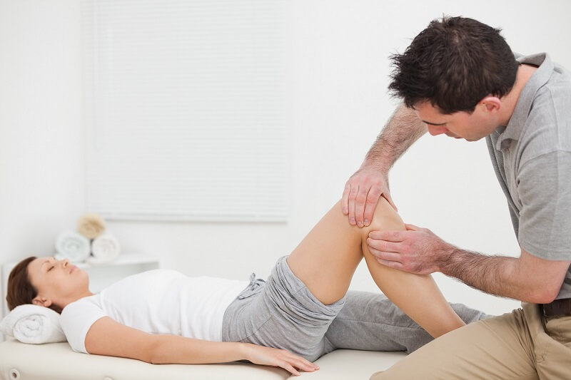 Osteopath and sports injury rehabilitation treatment of sprained knee