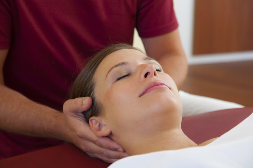 treatment of a trapped nerve by an osteopath to reduce neck pain and spine pain