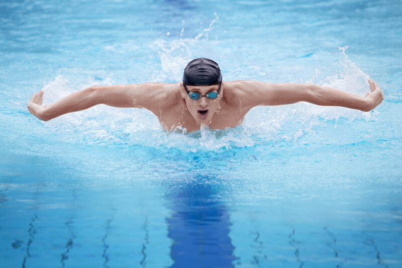 Man swimming movement with no shoulder pain following osteopathy treatment Cambridgeshire